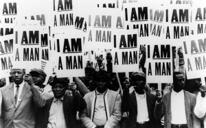 Striking members of Memphis Local 1733 hold signs whose slogan symbolized the sanitation workers' 1968 campaign. 1968